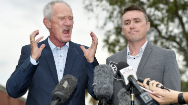 One Nation officials Steve Dickson and James Ashby answer questions at a press conference in Brisbane about lobbying efforts with America's NRA.
