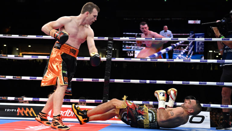 Next generation: Jeff Horn stands over Anthony Mundine as he hits the canvas.