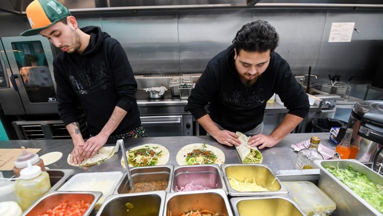 Chefs at work inside Deliveroo's dark kitchen in Windsor.