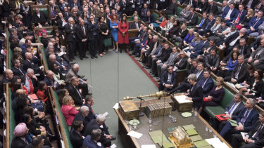 Britain's Prime Minister Theresa May at center right front row, speaks to lawmakers in the House of Commons.