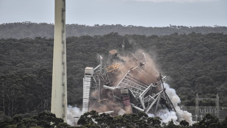 Going: The old Alcoa power plant came crashing down last week as it was blown up.