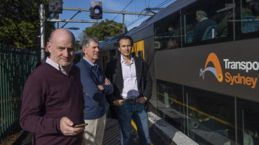 Local residents Brian McGlynn, left, Ian Links and Stefano Palomba at Wollstonecraft station.