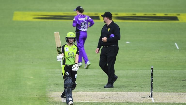 Sydney Thunder batsman Naomi Stalenberg celebrates her half century at Manuka Oval.