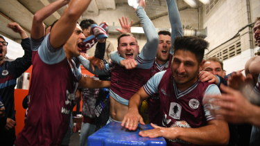 What an upset: APIA Leichhardt celebrate their FFA Cup win over Melbourne Victory.