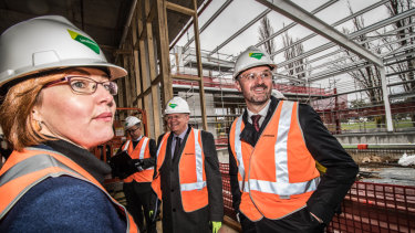 ACT Minister for Higher Education Meegan Fitzharris, vice-chancellor Brian Schmidt (second from left), and Chief Minister Andrew Barr took a tour of the work in progress on Tuesday.