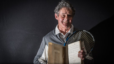 Reid Tennis Club president Terry Walker with the treasured book of minutes that records the very first meeting of the club 90 years ago.