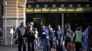 Sally Capp, second from left, on Flinders Street on Wednesday talking with the Salvation Army's Brendan Nottle.