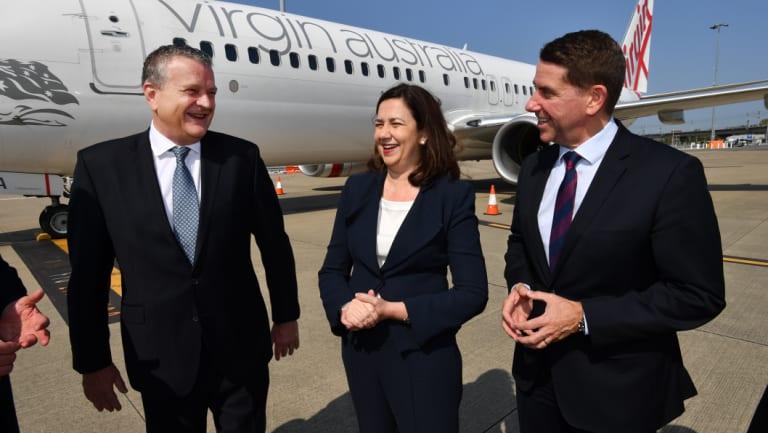 Virgin Australia group executive Rob Sharp, Queensland Premier Annastacia Palaszczuk and State Development Minister Cameron Dick at Brisbane Airport.