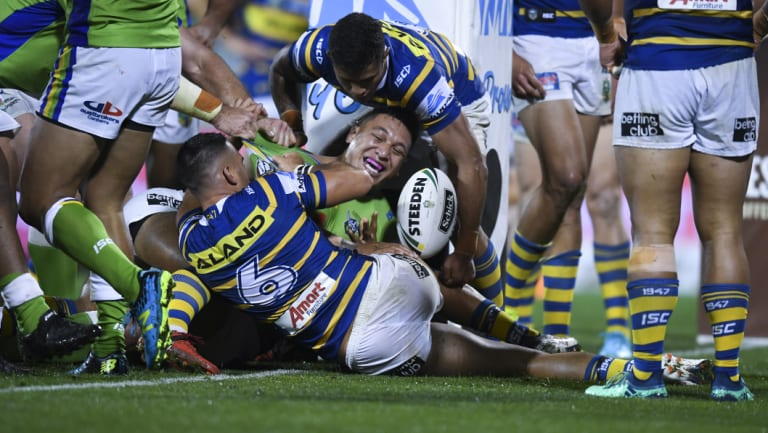 Sheer brawn: Joshua Papalii celebrates after muscling his way across the stripe.