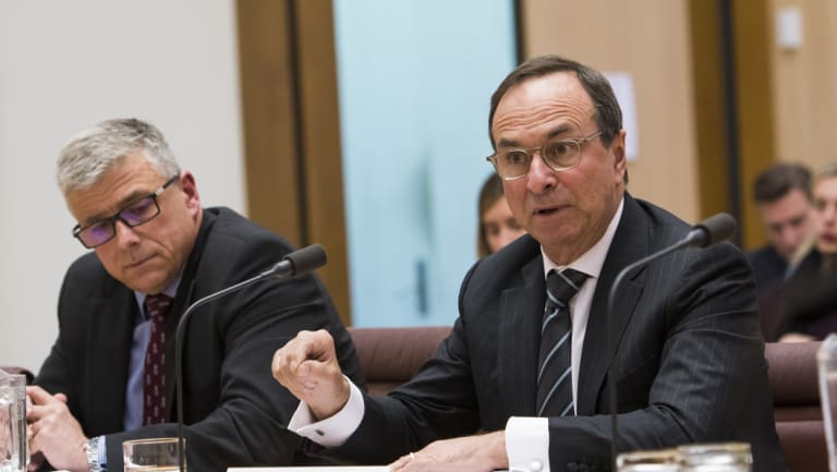 7-Eleven chief executive officer Angus McKay and chairman Michael Smith give evidence at the senate inquiry into franchising.