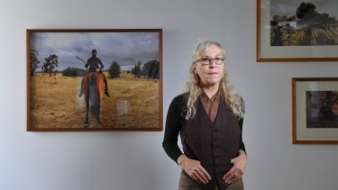 Photo media artist Anne Zahalka in front of her work earlier this year.