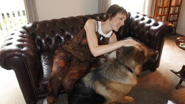 Gungahlin woman Tanya Gendle at home with her dog Atlas.