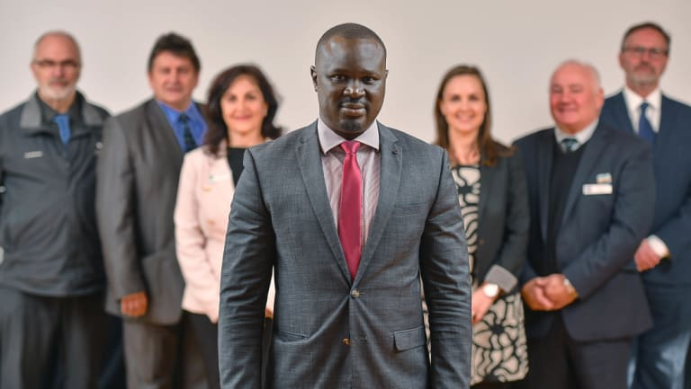 We support you: Sudanese community leader Maker Mayek (centre) flanked by the mayors of Knox, Hume, Whittlesea, Darebin, Melton and Moreland.