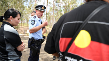 Queensland Police Acting Inspector Brett Wendt talks to protesters in Deebing Heights on Thursday.