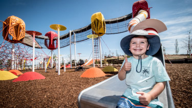 Oscar Hanley, two, of Waramanga enjoying the new Ridgeline Park playground at Denman Prospect.
