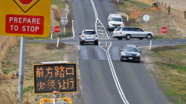 Problematic intersection. Chinese signage was erected earlier this year.