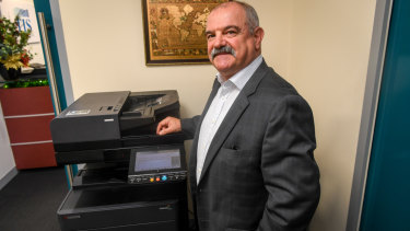 Rocky Tempone's business still fires up the fax machine on his multi-function device each week.
