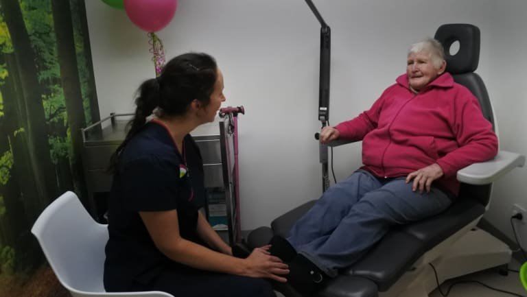 Nicole Hart, owner of Brindabella Podiatry, consults with patient Robin Bontjer, of Kambah, in the new Canberra Ingrown Toenail Clinic at Tuggeranong.