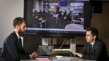 Brighton Grammar teacher Rob Hayward, left, discusses his teaching video with coach Mark Dowley