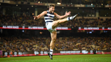 On point: Tom Hawkins kicked four goals for the Cats at the MCG on Friday night.
