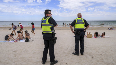 Police patrol Chelsea beach after the crime spree overnight.