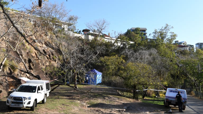 Police forensic officers attend to a crime scene at Kangaroo Point where human remains were found.