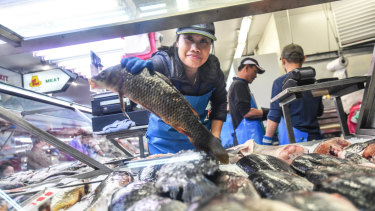 Lan Do notices more people buy fish when drought pushed meat and produce prices higher.