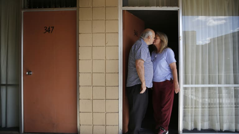 Dave Frazier and Dawn Robinson outside their Fireside Inn motel unit in downtown Reno.