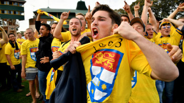 Canary yellow fever: Sydney University supporters taunt their Warringah counterparts .
