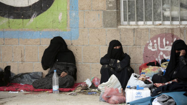 Displaced Yemeni women, who fled their homes because of fighting the port city of Hodeida, sit in a school in Sanaa last weekend.