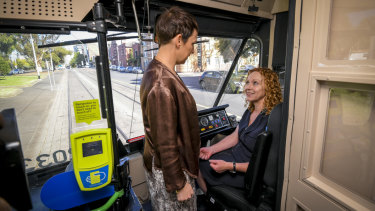 Minister for Roads Jaala Pulford (left) and Minister for Public Transport Melissa Horne  on a route 75 tram on Monday.