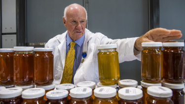 Bruce White in his long-standing judging role in the honey competition at the Royal Easter Show.