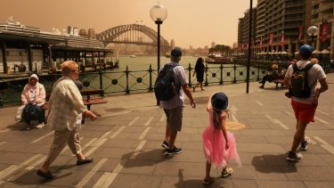 A strong wind change has swept dust over Sydney on Thursday.