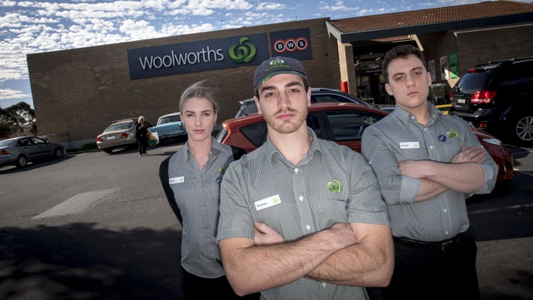 Woolworths employees Sarah Cleary, Andrew Berecz and Loukas Kakogiannis outside the chain's Moorabbin store.