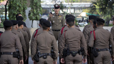 A police briefing outside a polling station before the start of voting in Bangkok on Sunday.