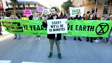 Extinction Rebellion protesters have held placards and banners in front of many infuriated drivers.