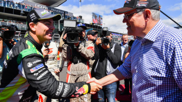 Prime Minister Scott Morrison, pictured here yesterday at the Bathurst 1000, will headline a major fundraiser in Sydney tomorrow to aid Dave Sharma's Wentworth campaign.