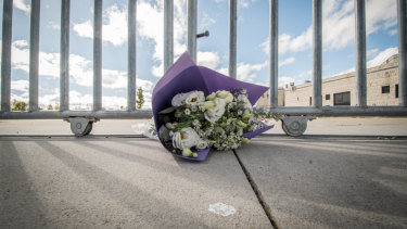 A solitary bunch of flowers at the gate of the Islamic centre in Monash on Saturday following the terrorist attack in Christchurch.