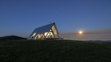 The hut is like a beacon as the sun rises.