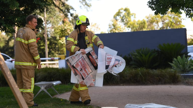 A firefighter is seen carrying a hazardous material bag into the South Korean consulate in Melbourne on Wednesday.