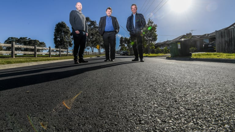 Jim Appleby of Downer, Hume mayor Geoff Porter and Peter Tamblyn of Close the Loop on Rayfield Avenue.