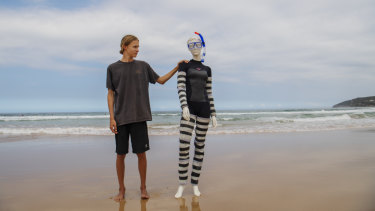 Tom Denby with his wetsuit to protect divers from shark bites.