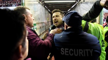 Security and police swooped on a Manly fan, centre, who confronted Melbourne Storm's Will Chambers on Saturday night at Lottoland.