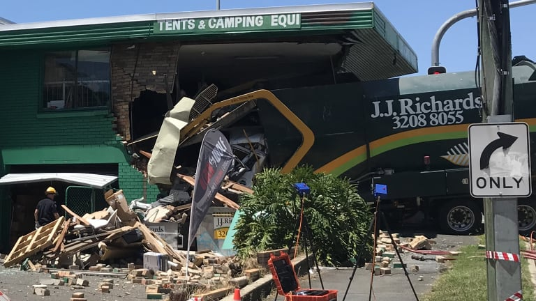 A truck driver has died after crashing into the Tentworld camping shop at Windsor.