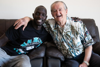 Mariners star Ruon Tongyik and his 82-year-old neighbour, Remo Pertot.