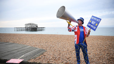 Pro-remain protester Steve Bray protests on a beach at Brighton, where the Labour conference is debating the party's stance on Brexit.