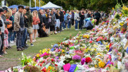 Members of the public at a makeshift memorial for the victims of the mosque mass murders at Botanical Gardens in Christchurch.