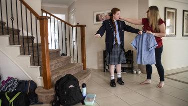 Lara White checks her uniform ahead of school returning.
