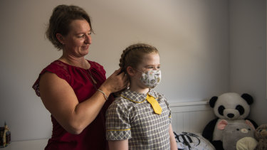Vaccinations and masks may influence how long a student will have to isolate