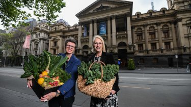 Rebecca Scott (L) of Moving Feasts and Lord Mayor Sally Capp (R) outside the Melbourne Town Hall.